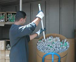 man placing fluorescent tubes in bin