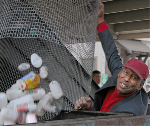 man dumps plastic bottles